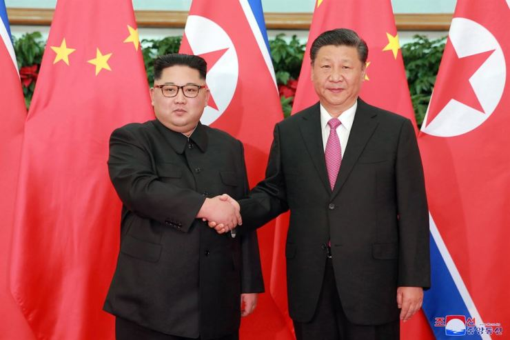 A photo released by the official North Korean Central News Agency (KCNA), the state news agency of North Korea, shows North Korean leader Kim Jong-un, left, shaking hands with Chinese President Xi Jinping during their meeting in Dalian, China, 08 May 2018. EPA