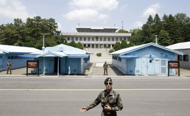 In this June 12, 2019, photo, a South Korean soldier gestures during a press tour at the Panmunjom in the demilitarized zone (DMZ), South Korea. U.S. President Donald Trump invited North Korean leader Kim Jong-un to shake hands during a visit by Trump to the DMZ. AP-Yonhap
