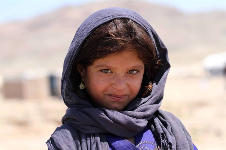 An Afghan girl, who was displaced internally due to conflict and disaster, poses for a photograph at her temporary shelter provided by the United Nations High Commissioner for Refugees on the outskirts of Herat, Afghanistan, June 17. EPA