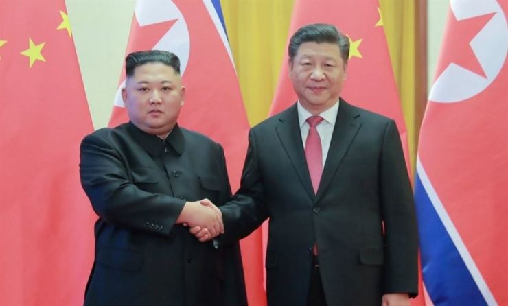 North Korean leader Kim Jong-un shakes hands with Chinese President Xi Jinping during their summit at the Great Hall of the People in Beijing in January. Xi will start a two-day trip to North Korea, Thursday, the first since he took office in 2013. Yonhap