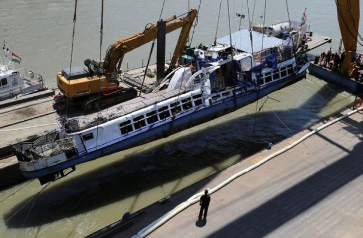 The Mermaid, a Hungarian boat which sank in the Danube River near Margaret Bridge, is lifted from the water during a salvage operation in Budapest, Hungary, on June 11, 2019. MARKO DJURICA/REUTERS