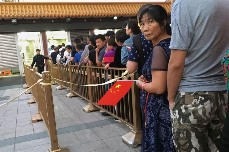 People queue to pass a security check point outside Tiananmen Square on June 4, 2019. AFP-Yonhap