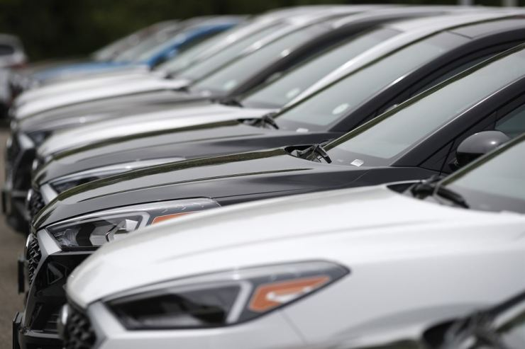 In this May 19 file photo, a line of unsold 2019 Tucson sports-utility vehicles sits at a Hyundai dealership in Littleton, Colo., U.S. AP
