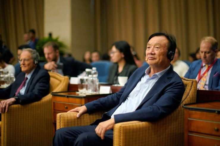 Huawei founder Ren Zhengfei attends a panel discussion at the company headquarters in Shenzhen, Guangdong province, China, June 17. Reuters