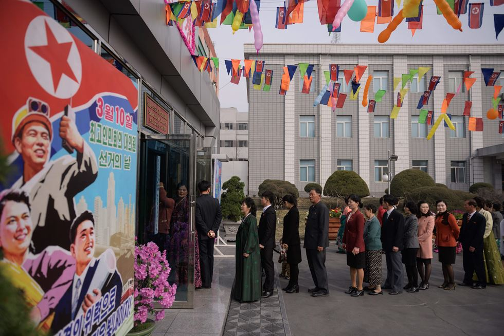 A voter uses an ID card to register to cast their ballot at the '3.26 Pyongyang Cable Factory' during voting for the Supreme People's Assembly elections, in Pyongyang on March 10, 2019. AFP-Yonhap