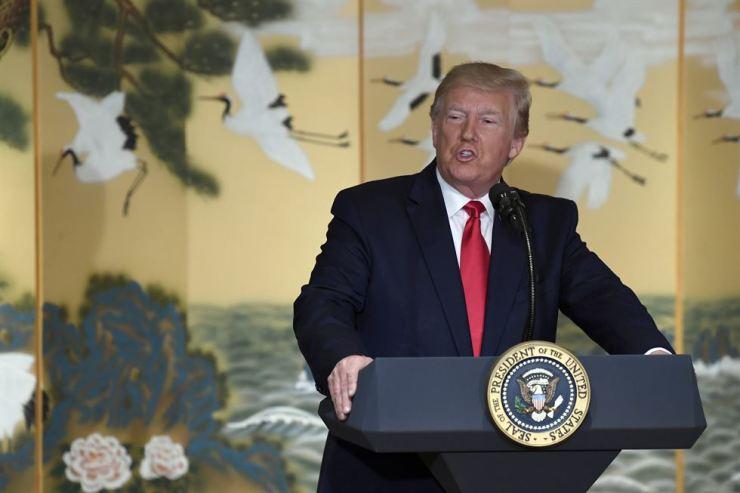 U.S. President Donald Trump speaks to Korean business leaders in Seoul, Sunday. AP