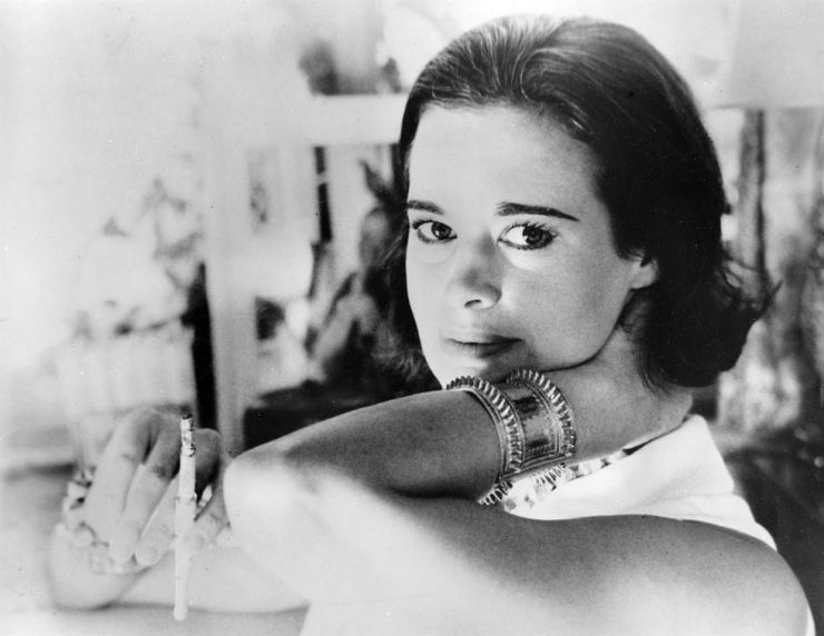 In this Jan. 4, 1964, file photo, railroad heiress Gloria Vanderbilt poses for a photograph. Vanderbilt, the intrepid heiress, artist and romantic who began her extraordinary life as the 'poor little rich girl' of the Great Depression, survived family tragedy and multiple marriages and reigned during the 1970s and '80s as a designer jeans pioneer, died on June 17, 2019, at the age of 95. AP