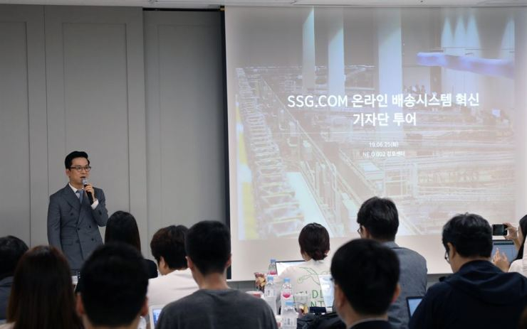 SSG.com CEO Choi Jung-woo delivers an opening speech during an NE.O 002 logistics center press tour in Gimpo, Gyeonggi Province, Tuesday. Courtesy of SSG.com