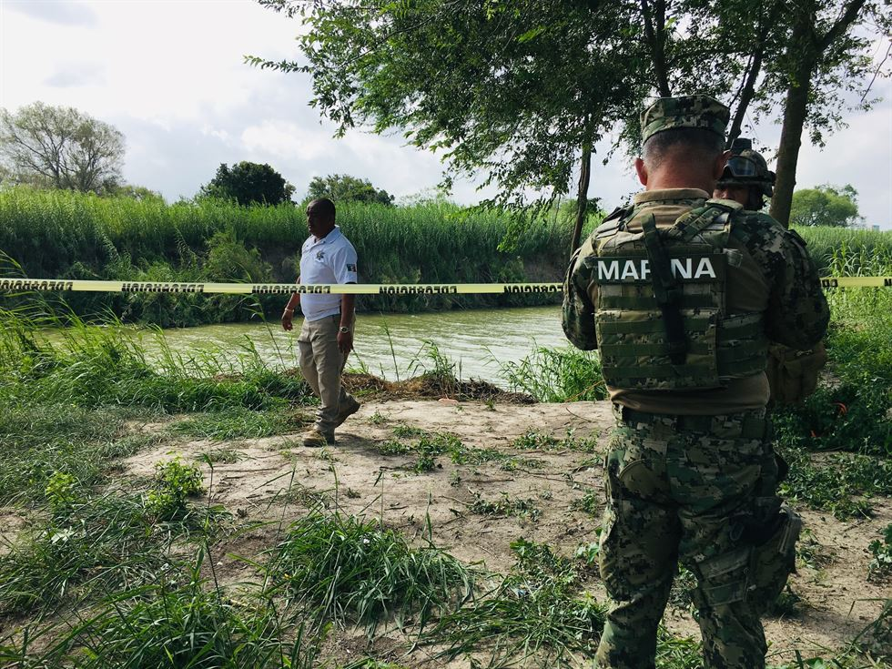 Authorities stand behind yellow warning tape along the Rio Grande bank where the bodies of Salvadoran migrant Oscar Martinez Ramirez and his nearly 2-year-old daughter Valeria were found, in Matamoros, Mexico, Monday, June 24, 2019, after they drowned trying to cross the river to Brownsville, Texas. Martinez' wife, Tania told Mexican authorities she watched her husband and child disappear in the strong current. (AP Photo/Julia Le Duc)