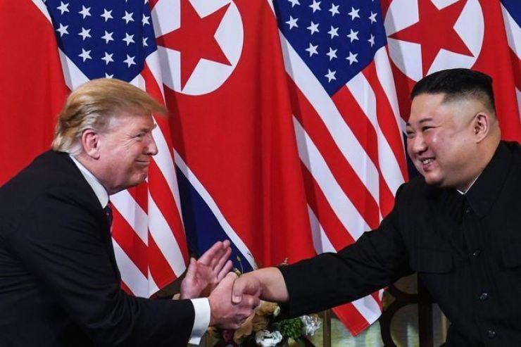 U.S. President Donald Trump, left, shakes hands with North Korean leader Kim Jong-un on Feb. 27, at Sofitel Legend Metropole Hanoi in Vietnam. Korea Times file
