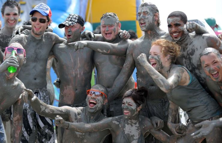 In this July 18, 2010, file photo, people enjoy the Boryeong Mud Festival at Daecheon Beach at Boryeong, South Chungcheong Province. Korea Times file