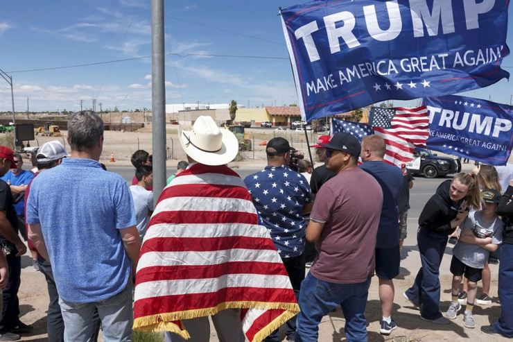Supporters of U.S. President Donald Trump stand near the border during a rally as Trump visits the U.S.-Mexico border in Calexico, Calif., U.S., April 5. Reuters