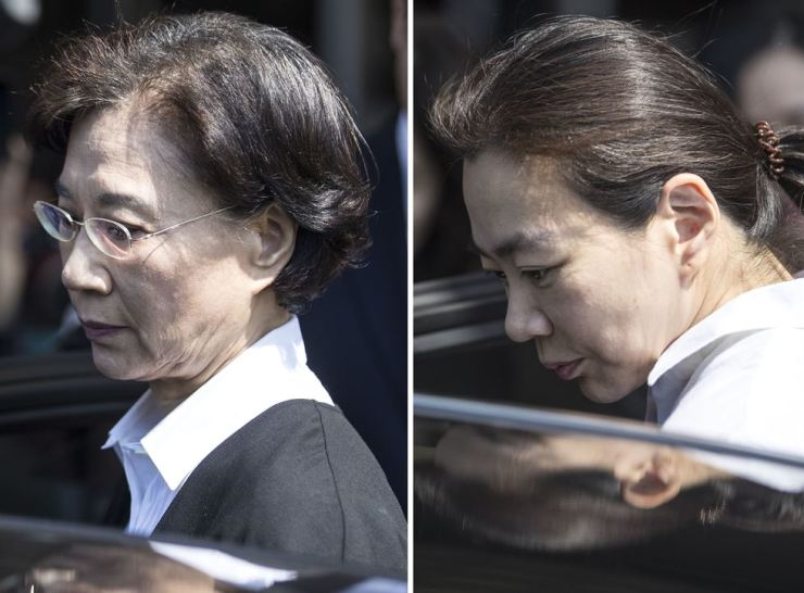 Lee Myung-hee, left, and Cho Hyun-ah leave the Incheon District Court, Thursday, after the ruling. Yonhap