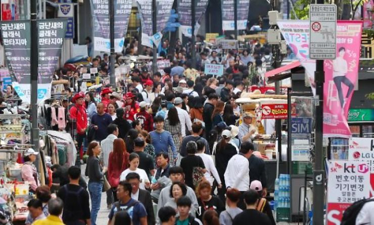 Myeong-dong, a shopping district in Seoul, is filled with foreign tourists. Korea Times file