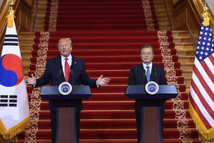 President Donald Trump, left, and South Korean President Moon Jae-in participate in a news conference at Cheong Wa Dae, Sunday, before they head to Panmunjeom in the Demilitarized Zone between two Koreas to meet North Korean leader Kim Jong-un. AP-Yonhap