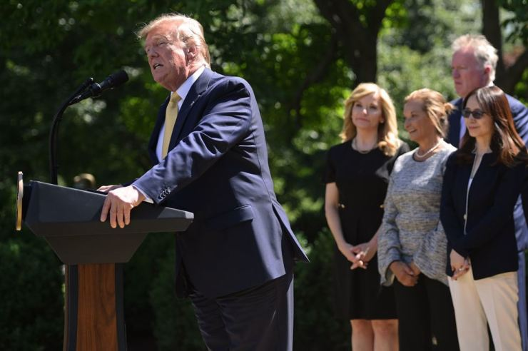 U.S. President Donald Trump speaks during an event about expanding health coverage options for small businesses and workers in the Rose Garden of the White House in Washington, DC, June 14. AFP-Yonhap