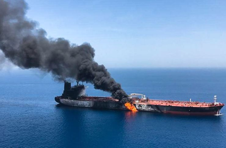 A picture obtained by AFP from Iranian News Agency ISNA on June 13 reportedly shows fire and smoke billowing from Norwegian owned Front Altair tanker said to have been attacked in the waters of the Gulf of Oman. AFP-Yonhap