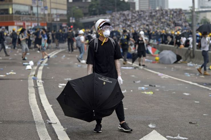 Protesters react during a rally against an extradition bill outside the Legislative Council in Hong Kong, June 12. The bill, which has faced immense opposition from pan-democrats, the business sector, and the international community, would allow the transfer of fugitives to jurisdictions which Hong Kong does not have a treaty with, including mainland China. Critics of the bill have expressed concern over unfair trials and a lack of human rights protection in mainland China. EPA