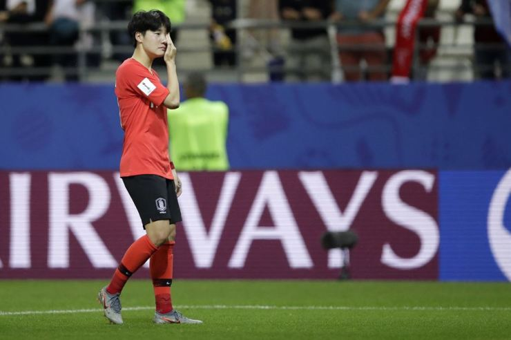 Korea's Lee Geum-min reacts following her team's 2-1 loss following the Women's World Cup Group match between Norway and Korea at the Stade Auguste-Delaune in Reims, France, Monday. AP