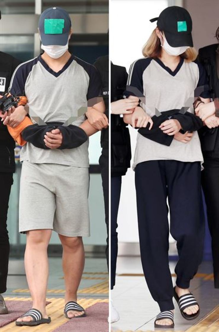 Cho, 21, left, and Gyeon, 18, who left their 7-month-old baby alone at home for days, are led out of Michuhol District Police Station in Incheon to attend a court hearing on arrest warrants for them, Friday. The court issued the warrants later in the day. / Yonhap