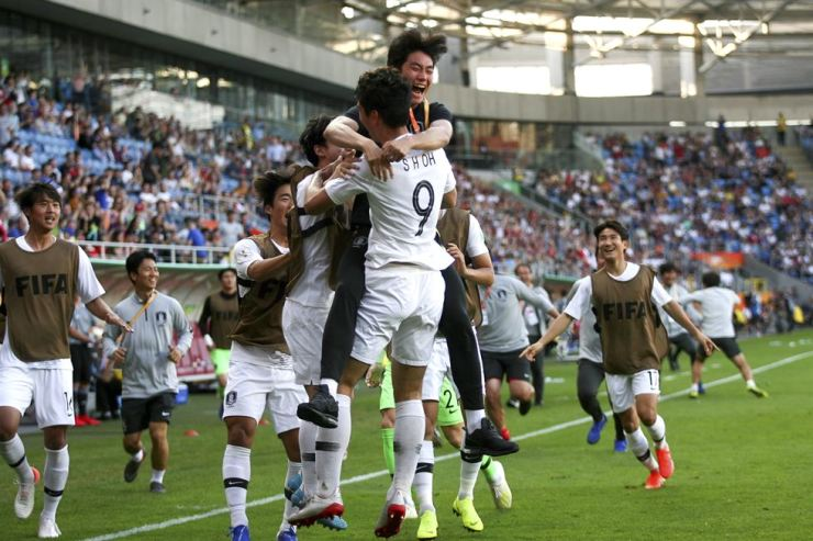 Korean players celebrate after defeating Japan in the FIFA Under-20 World Cup game at the Arena Lublin in Lublin, Poland, June 4. EPA