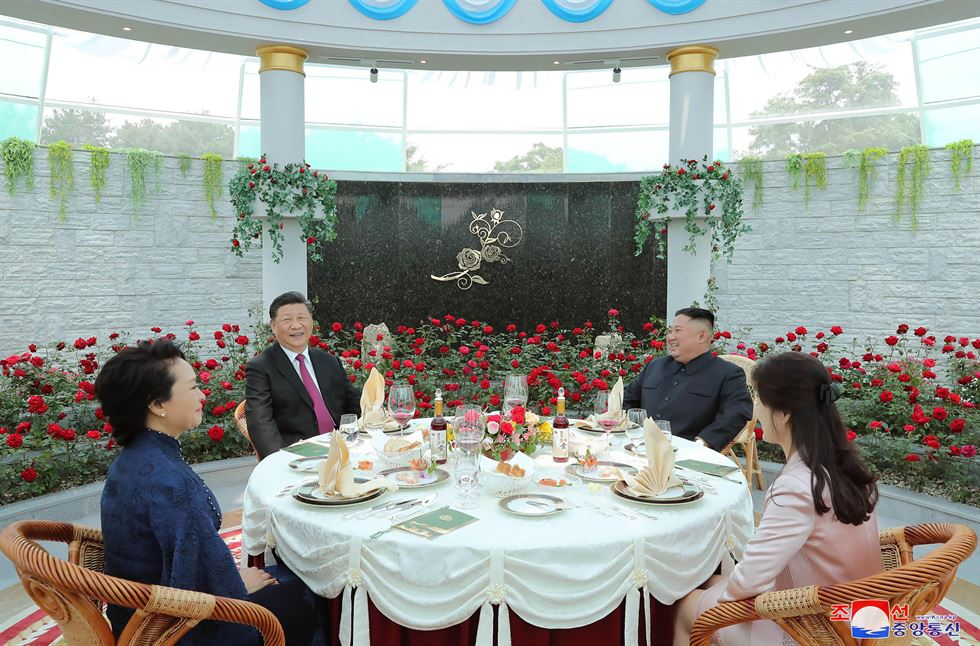 North Korean leader Kim Jong-un, his wife Ri Sol-ju, Chinese President Xi Jinping and his wife Peng Liyuan sit at a table outside the Kumsusan Guest House in Pyongyang in this photo provided Friday by North Korea. The image is as provided and cannot be independently verified. The Korean language watermark on the image as provided by the source reads, 'KCNA,' the abbreviation for the Korean Central News Agency.           (Korean Central News Agency/Korea News Service via AP)