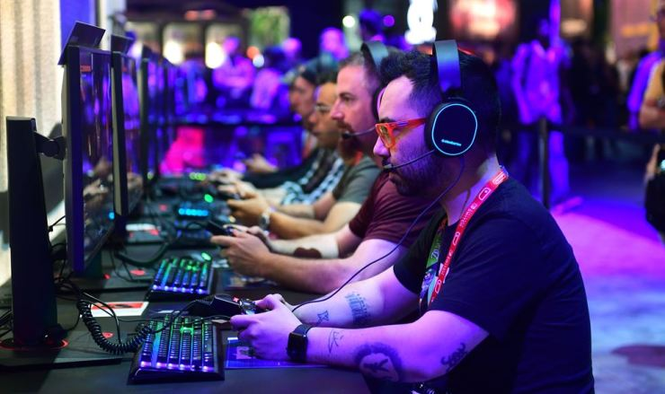 Gaming fans play 'Wolfenstein: Youngblood' from Bethesda at the 2019 Electronic Entertainment Expo, also known as E3, in Los Angeles, Califor., U.S., June 12. AFP