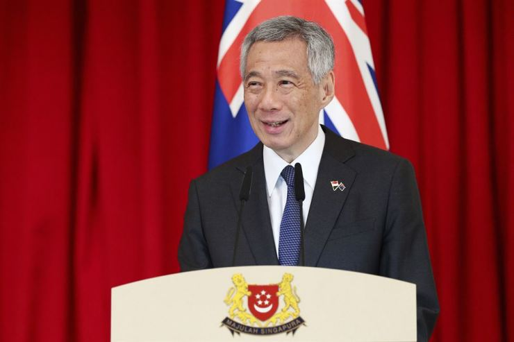 Singaporean Prime Minister Lee Hsien Loong speaks during a joint press conference at the Istana or Presidential Palace in Singapore, June 7. AP