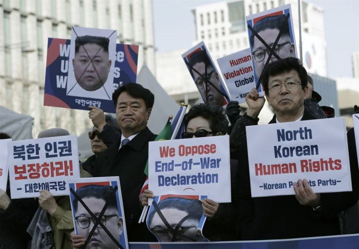 In this Feb. 26 file photo, South Korean protesters and North Korean defectors hold portraits of North Korean leader Kim Jong-un during a rally urging the United States to discuss North Korean human rights issues in the upcoming summit between U.S. President Donald Trump and Kim near the U.S. embassy in Seoul. The Seoul-based human rights group Transitional Justice Working Group said on June 11 that it has carried out research to identify hundreds of sites where witnesses claim North Korea has carried out public executions as it continues to aggressively use the death penalty to intimidate its citizens. AP