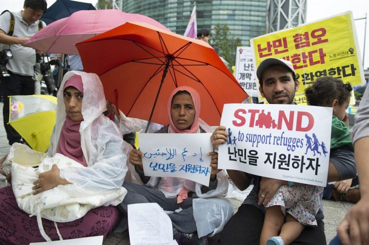 Asylum seekers participate in a rally organized by Amnesty and NANCEN in front of Bosingak bell pavilion in central Seoul, last September, calling for better treatment and review processes. / Korea Times file