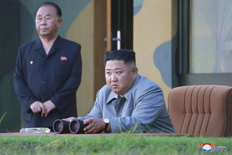 North Korean leader Kim Jong-un watches the missile test on Thursday, in this photo provided Friday by the North Korean government. AP-Yonhap