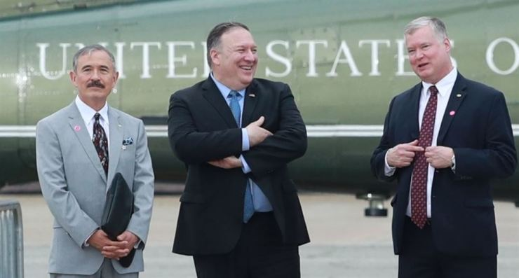 U.S. Special Representative for North Korea Stephen Biegun, right, speaks with Secretary of State Mike Pompeo, center, during their visit to Osan Air Base in South Korea, Sunday. Yonhap