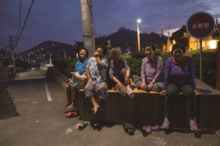 Five women pose with big smiles in this June 2018 photo taken in Manho-dong, Mokpo City. Starting in 2014 on the southern island of Jeju, photographer Im Jay-cheon embarked on the discovery photobook sequel and has since released three photobooks, including 'Jeollado.' / Courtesy of Noonbit Publishing Co.