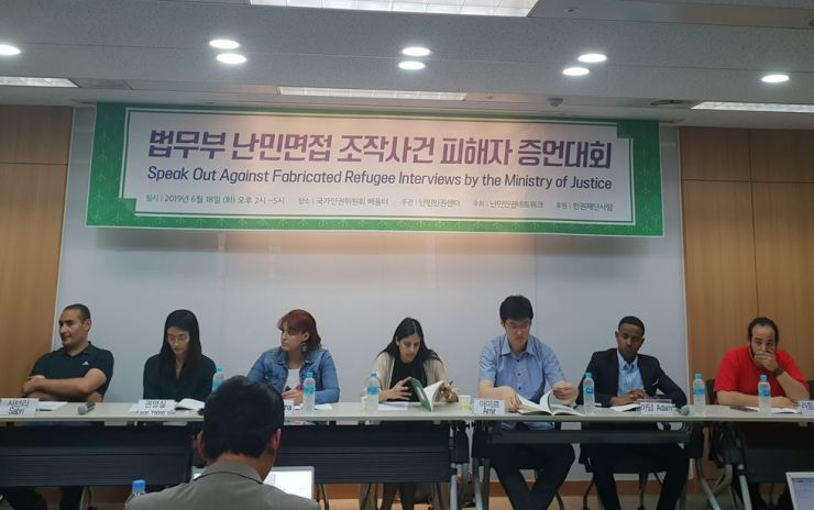 Asylum seekers in Korea and their translators attend a NANCEN-organized press conference at the National Human Rights Commission of Korea in Seoul, June 18, to disclose the immigration office's systematic falsification of refugee testimony by Arab and Muslim applicants. / Korea Times photo by Lee Suh-yoon