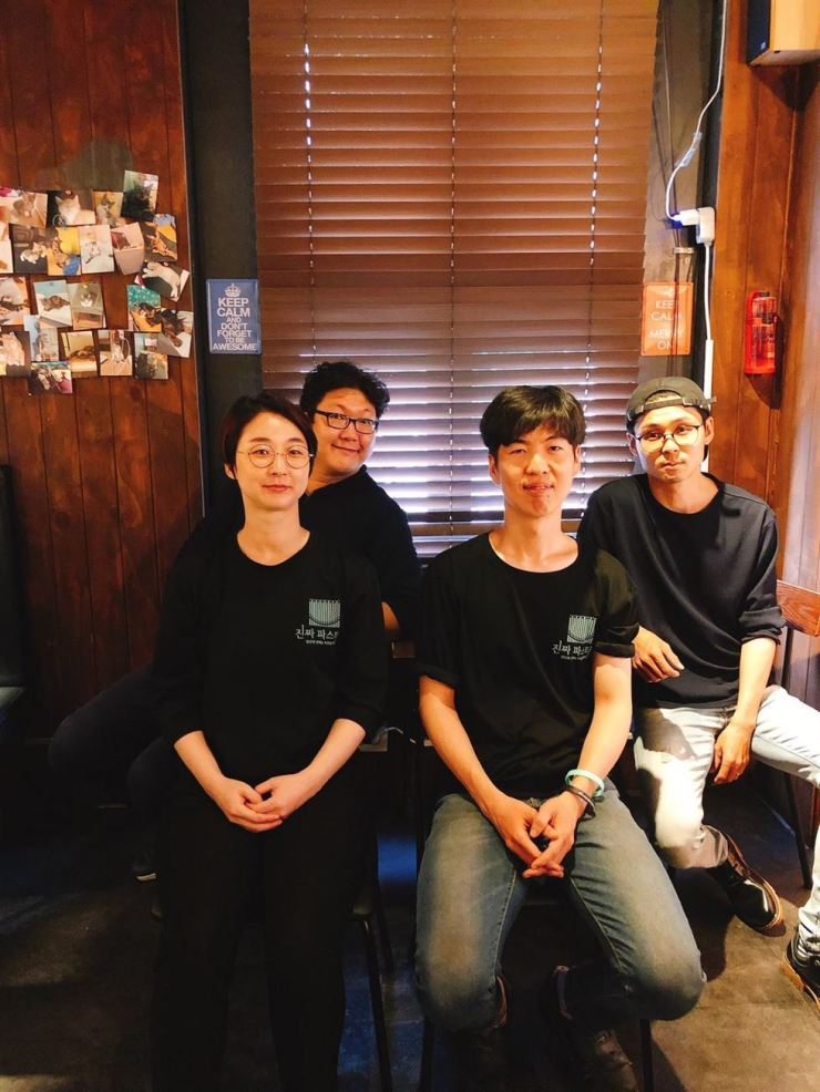 Oh In-tae, right, an owner of Italian bistro 'Zinjja Pasta,' pose with his business partners at his restaurant in Mapo-gu, western Seoul. / Courtesy of Zinjja Pasta