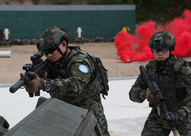 Soldiers of the 11th group of the Republic of Korea Army's Hanbit unit, participating in United Nations peacekeeping operation missions in South Sudan, conduct a firearms exercise at a training field in South Korea's International Peace Supporting Standby Force base, Incheon, June 20, weeks before its dispatch to the African region. Courtesy of ROK Army