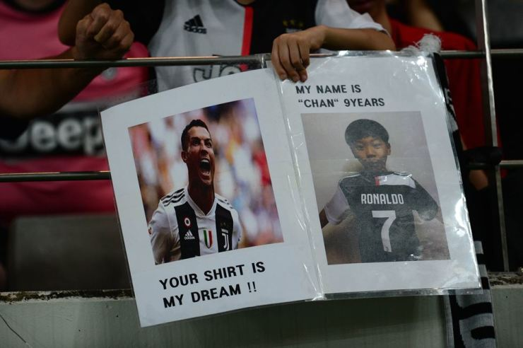 A boy holds his photo and that of Cristiano Ronaldo at the Seoul World Cup Stadium on July 26. Korea Times photo by Shim Hyun-chul