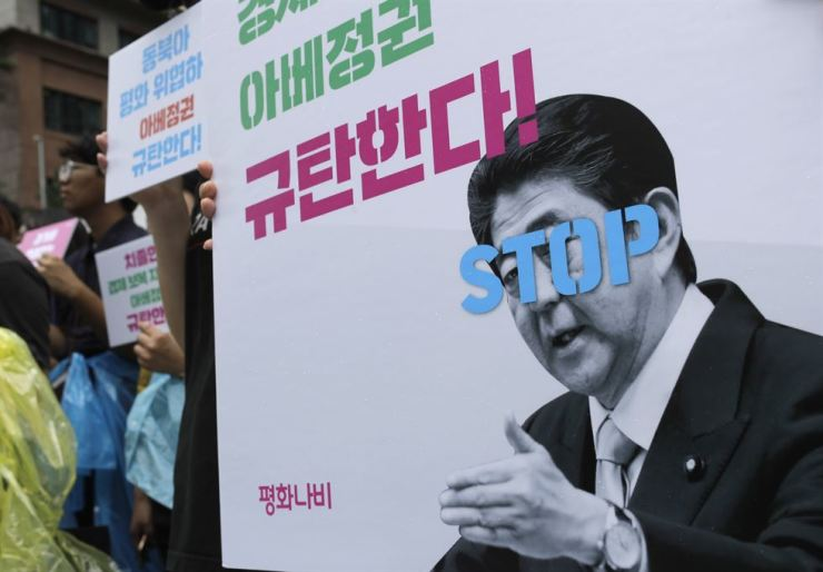 Korean students stage a rally near the Japanese Embassy in Seoul, Wednesday, to denounce the Japanese government's recent decision to restrict the export of some key industrial materials to Korea. AP