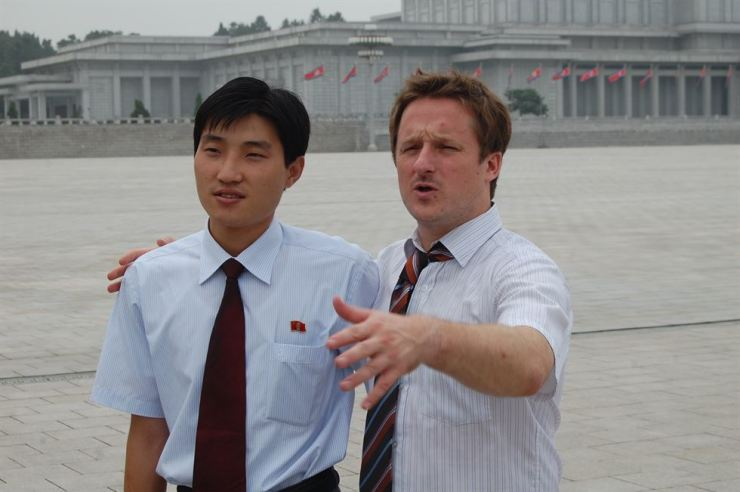 Michael Spavor, right, poses with a North Korean in front of Kumsusan Palace of the Sun in Pyongyang, North Korea, Aug. 15, 2010.   / Korea Times photo by Jon Dunbar