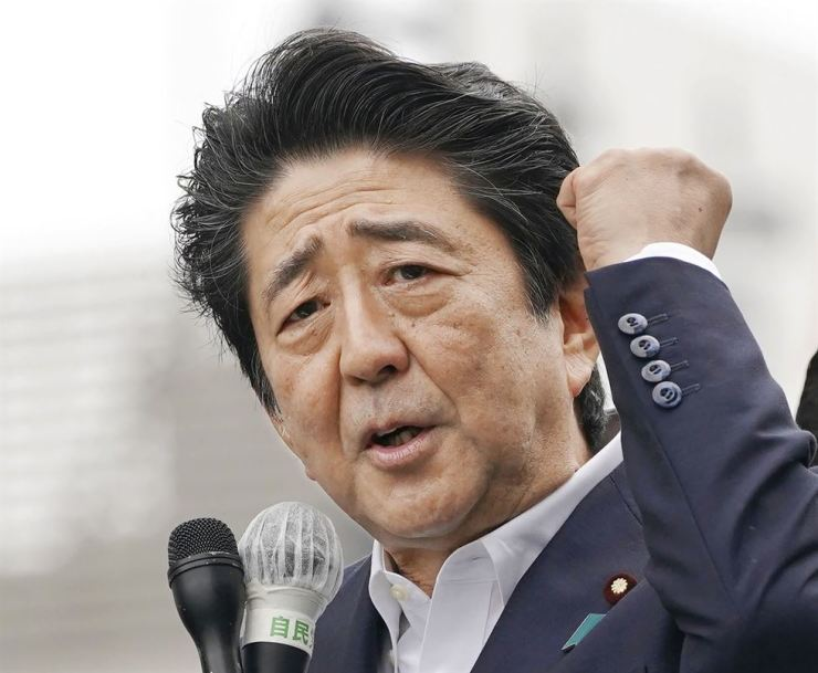 Japan's Prime Minister and leader of the Liberal Democratic party Shinzo Abe delivers a speech on a street ahead of the Upper House election, in Funabashi, near Tokyo Sunday, July 7. AP-Yonhap