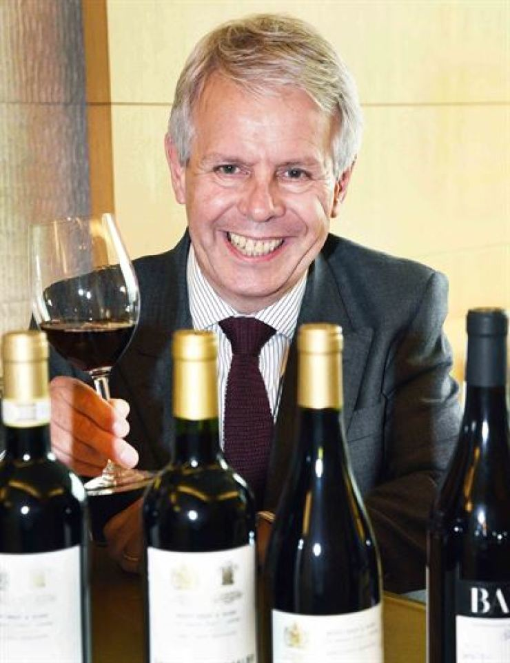 Mark Pardoe, wine director of Berry Bros. & Rudd, poses with a glass of wine and bottles of Barolo, Nero d'Abola and Montelpulciano d'Abruzzo from The Wine Merchant's range at the Marriott Hotel in Seoul, Tuesday. / Courtesy of Homeplus