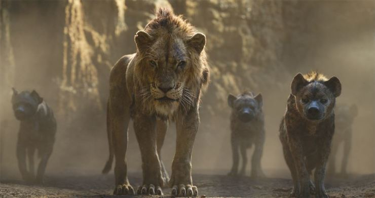 This image released by Disney shows Scar, voiced by Chiwetel Ejiofor, center, in a scene from 'The Lion King.' Disney via AP