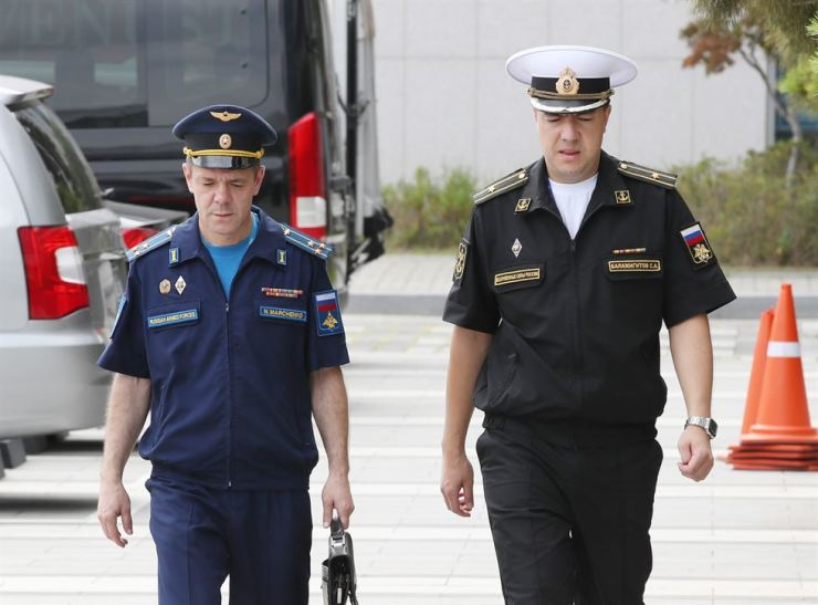 Russian Deputy Military Attache Nikolai Marchenko, left, and Assistant of the Military Attache Sergey A. Balazhigitov arrive at the Joint Chiefs of Staff building in Seoul, Tuesday, summoned by the South Korean military after a Russian military plane violated South Korea's airspace in the East Sea twice the same day, following separate cases of the Korea Air Defense Identification Zone (KADIZ) violations by two other Russian bombers along with two other Chinese bombers earlier in the day. Yonhap