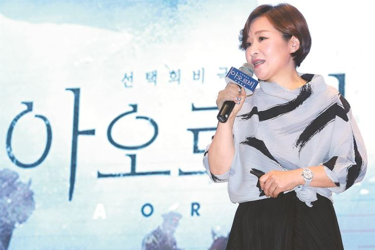 Nam Eun-ja, executive director of Oriental Brewery Company, speaks at a news conference on Yeouido, Friday, to promote the interactive short film 'AORB.' Courtesy of Oriental Brewery Company