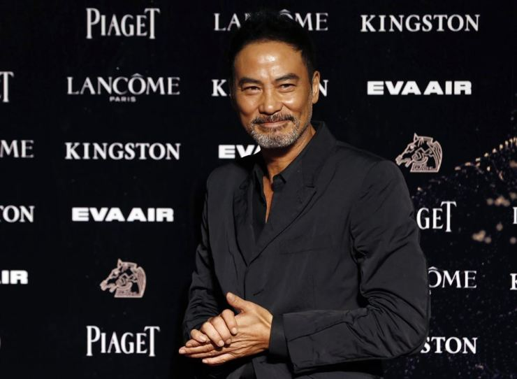 In this Nov. 21, 2015, file photo, Hong Kong actor Simon Yam poses on the red carpet at the 52nd Golden Horse Awards in Taipei, Taiwan. Yam has been stabbed while attending an event in southern China. Police say his injuries are not life-threatening and and a suspect has been detained. The motive is unclear. AP