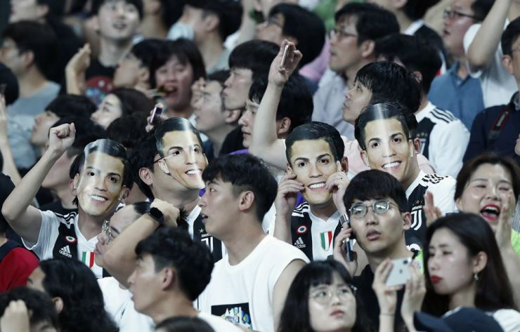 South Korean soccer fans wear masks of Cristiano Ronaldo of Juventus prior to a friendly match between Juventus and Team K League at the Seoul World Cup Stadium in Seoul, South Korea, Friday, July 26, 2019. /AP-Yonhap