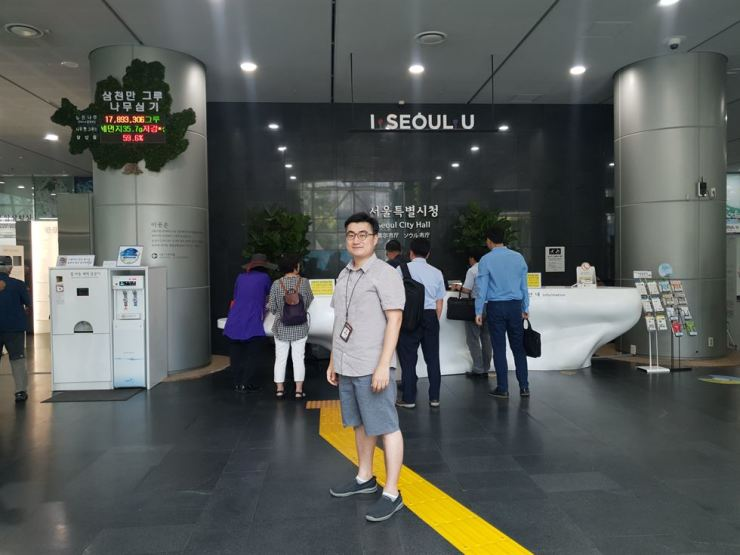 Lee Won-hyuk, 35, a civil servant at the environmental policy division of Seoul Metropolitan Government, stands inside the City Hall building, Thursday. / Korea Times photo by Lee Suh-yoon