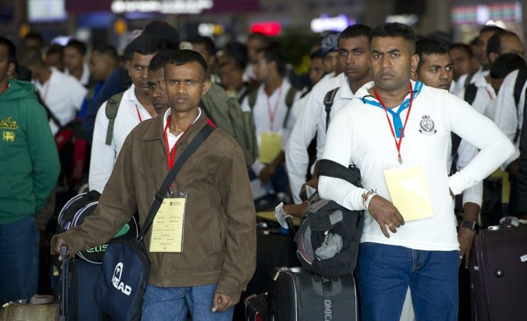 Foreign workers arrive at Incheon International Airport in this file photo. The government announced measures for better living conditions for migrant workers at company-provided dormitories. Korea Times file