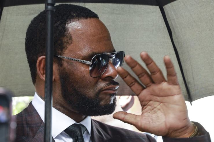 In this June 26 file photo, Musician R. Kelly departs from the Leighton Criminal Court building after a status hearing in his criminal sexual abuse trial in Chicago. Kelly is charged with racketeering, sex crimes against women and girls in sweeping New York federal indictment. AP