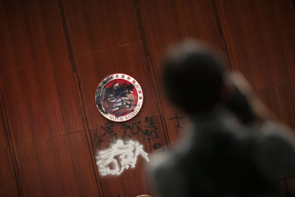 A smashed pane of glass and graffiti are seen at Hong Kong's Legislative Council during a media tour, Wednesday. Graffiti that reads 'Hong Kong is not China' is seen on the wall. Korea Times photo by Choi Won-suk